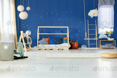 Dreamy bedroom with blue wall