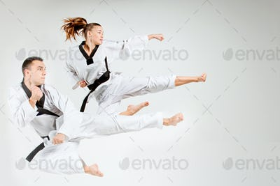 The karate girl and man with black belts