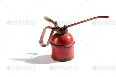 Small rusting vintage red oil can dispenser