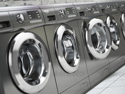 Row of washing machines in a public laundromat.