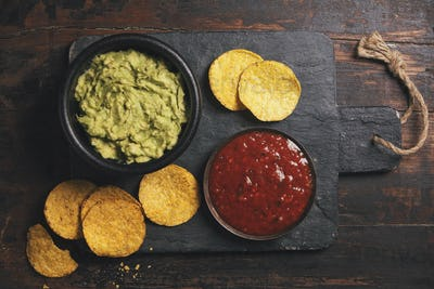 Mexican nachos chips with homemade fresh guacomole sauce and sal