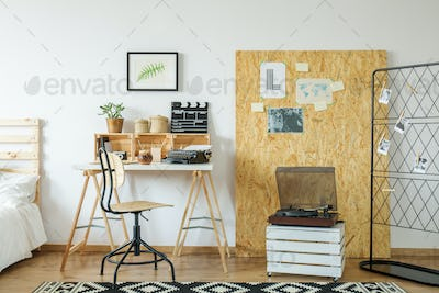 Room with desk and osb board