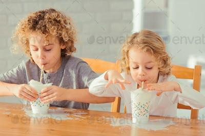 Boys spilling milk