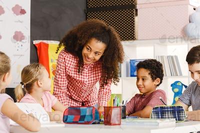 Smiling teacher explaining lesson