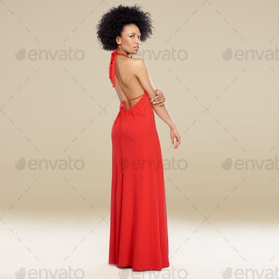 Elegant African American woman in a red gown