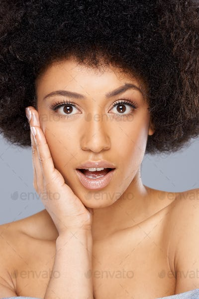 Beautiful surprised African American woman