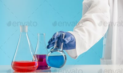 Experiments in a chemistry lab. conducting an experiment in the laboratory.