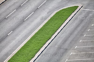 Aerial picture of an empty road and a parking lot.