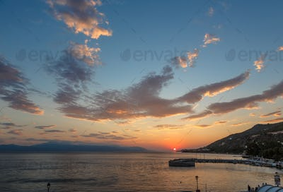 Sunset panorama view with sea and mountains, Greece