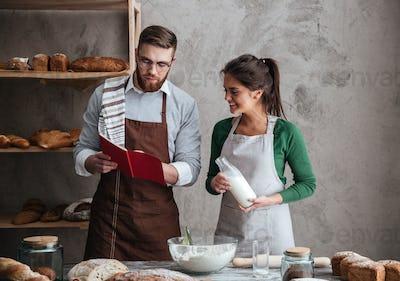 Couple reading recipe of bread