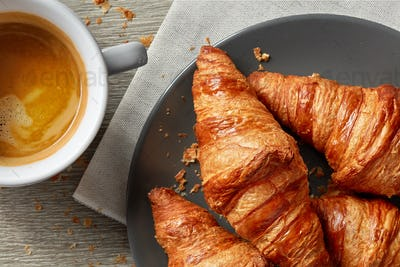 freshly baked croissants and coffee espresso