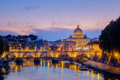 Famous citiscape view of St Peters basilica in Rome at sunset