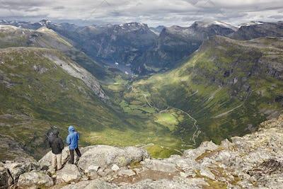 Hikers. Norwegian rocky mountain landscape. Norway highlight. Horizontal