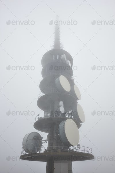Outdoor telecommunication antenna detail covered with fog. Vertical