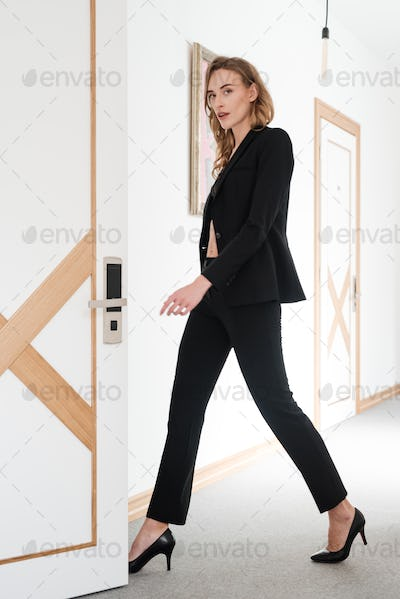 Full length portrait of sensual woman in suit and bra