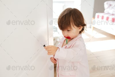 Shot of little girl with screw