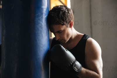 Pensive sportsman boxer thinking about training