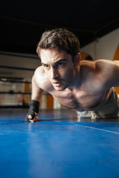 Vertical image of boxer doing push ups