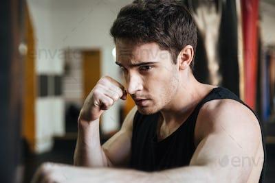 Focused boxer training in gym