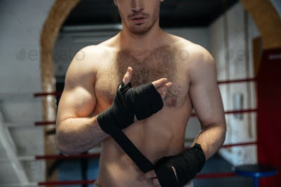 Cropped image of boxer wearing gloves