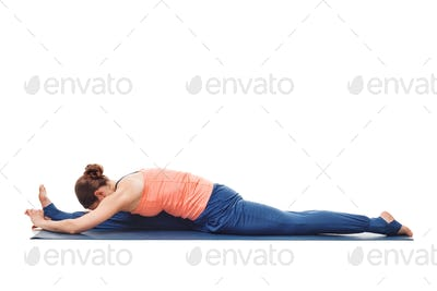 Woman doing Yoga asana Hanumanasana - monkey pose