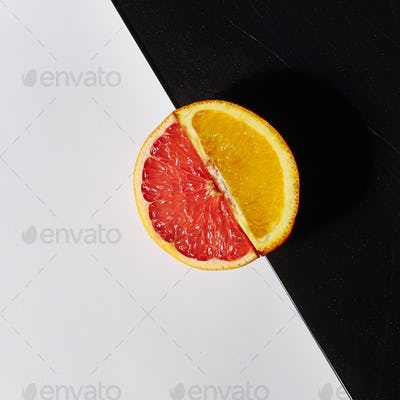 Grapefruit and orange citrus fruit halves