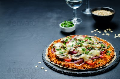 Sweet potato pizza crust with tomato, red onion and mushrooms