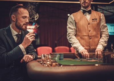 Upper class man gambling in a casino