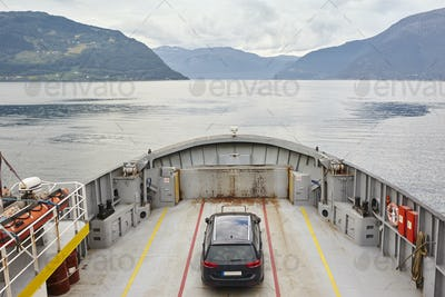 Norwegian fjord landscape with cruise and car vehicle. Travel background
