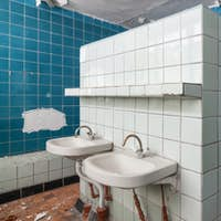 Bathroom with wash hand basin in the abandoned building