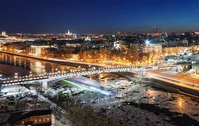 Bridge across the Moskva River with ice floes in winter
