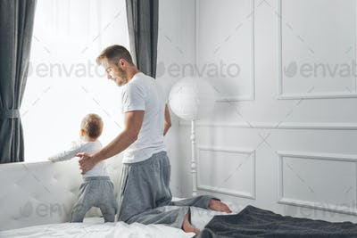 Father with his son looking out of the window