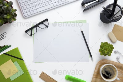 Blank Documents Surrounded By Office Supplies On Desk