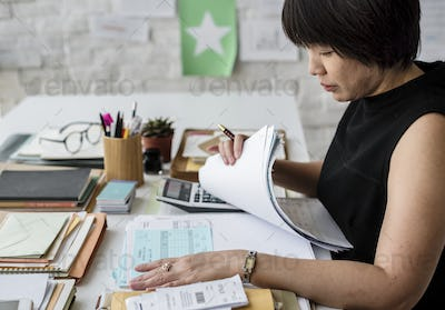 Adult asian woman working on payment bills accounting summary da