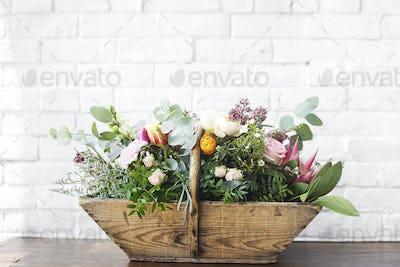 Variety Beautiful Flowers in Wooden Basket