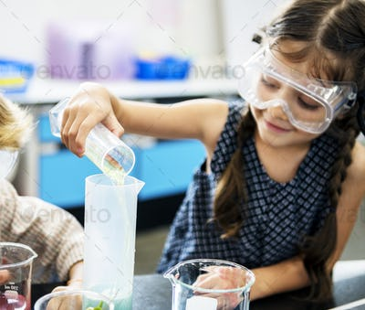 Kindergarten Students Mixing Solution in Science Experiment Labo