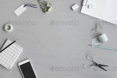 Design Space with Stationery on Gray Background