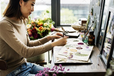 Woman Hand Writing Dry Flowers Plants Collection Details