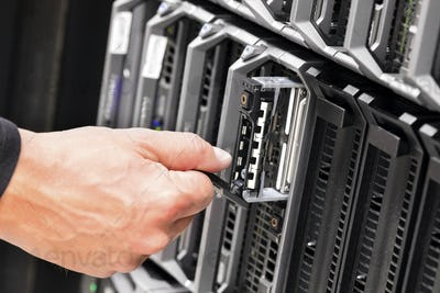 IT Technicians Repairing Harddrive on Server At Data Center
