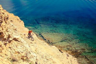 Mountain biker cycling at the seaside bike trail