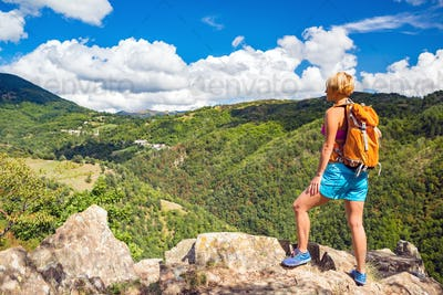 Hiking woman looking at inspirational mountains landscape