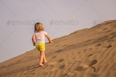 Walking up the sand dunes