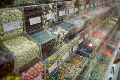 different sweets in boxes at candy shop