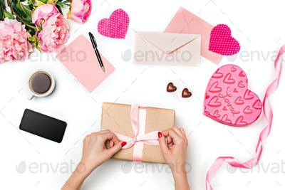 The female hands with gift box on white background