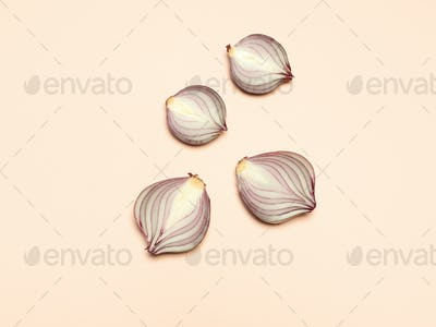 Red onion on a yellow background