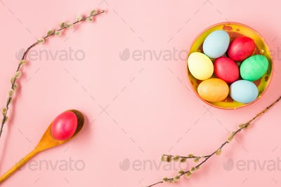 The top view of easter on pink table office workplace