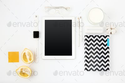 Top view of white office table with laptop
