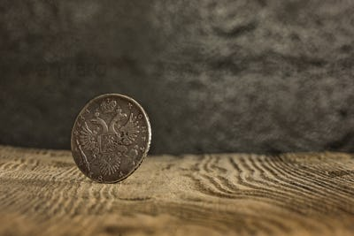 Closeup of old russian coin on a wooden background.