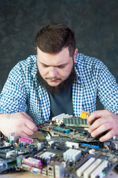 Service engineer work with computer motherboard