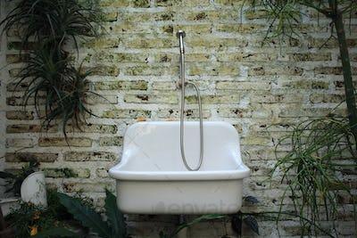Old sink on brick background